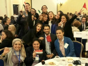 Professional fellows proudly waving their Egyptian and Tunisian flags after graduating from the program.